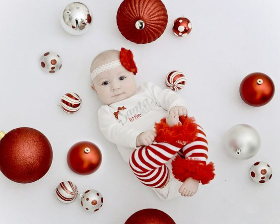 My little girl's first Christmas - Christmas photo shoot with ornaments.
