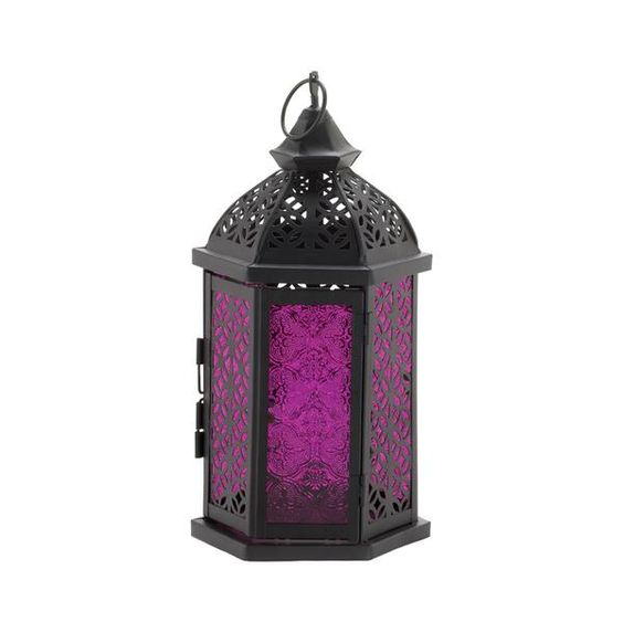 The brilliant purple of this lantern's pressed glass panels feature a pretty pattern that will shimmer and shine, filling your room with candlelit amethyst ambi