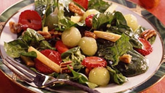 The ginger-honey dressing makes this fruit, cheese and nut combo irresistible!