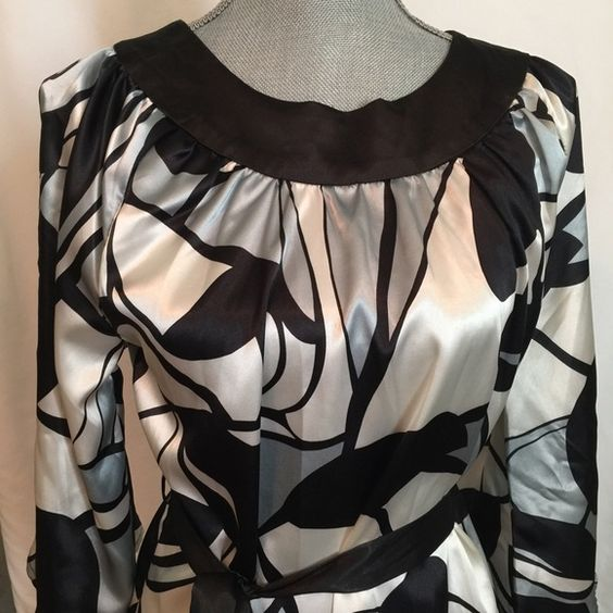 BCBG Maxazria BCBG Maxazria top size M.   3/4 length wide sleeves, rounded neckline, 3 tiny button closure back of neck. Matching fabric black belt with 2 belt loops. Geometric pattern in pale blue, white & black. Super cute, like NEW! BCBGMaxAzria Tops Tunics