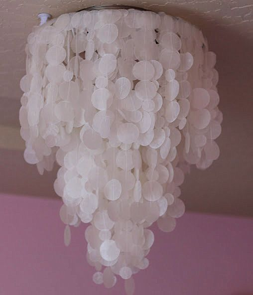 The Most Common Use For Wax Paper May Be Found In The Kitchen But It Can Also Be Used For A Glamoro Capiz Shell Chandelier Shell Chandelier Diy Light Fixtures