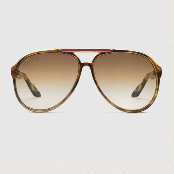 Gucci Aviator Sunglasses Brown tortoise oversized aviators with classic red and green stripes across top and along arms. Faint scratches on lenses, but you cannot see them when you are looking out! Purchased from Bloomingdales, comes with Gucci case and cleaning cloth. Gucci Accessories Sunglasses