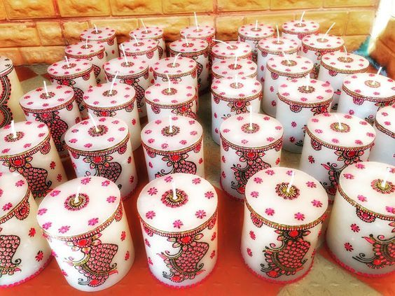 Trending Mehendi favors | Candles adorned with henna arts | Wedding favors | Scented candles | Henna candles | Indian wedding favors | Sangeet favor ideas | Mehndi gift inspiration | Function Mania | Unique Wedding Favours Your Guests will Definitely Love!