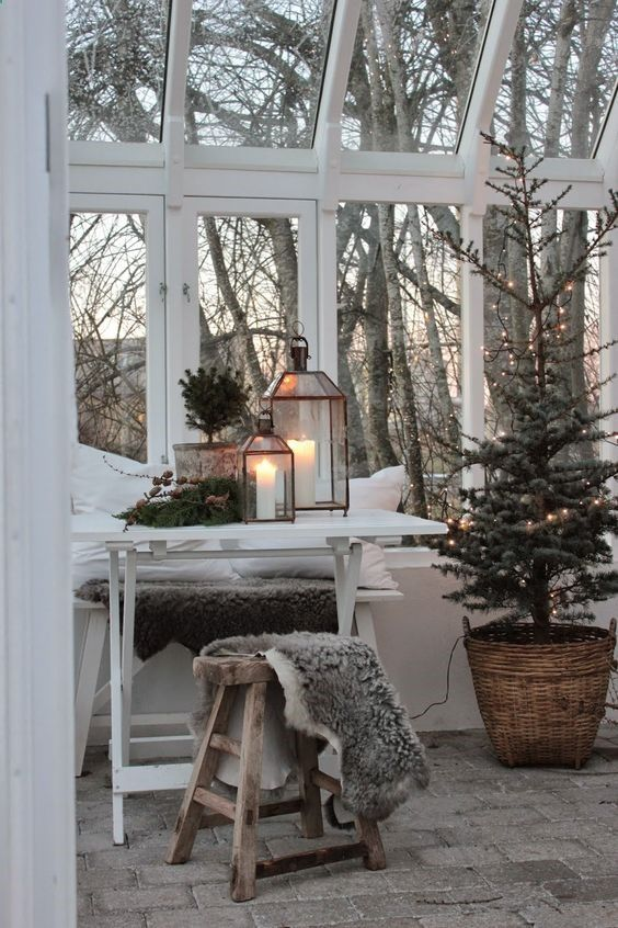 Swedish Christmas decorations and #Hygge in a sunroom conservatory with sheepskin throws