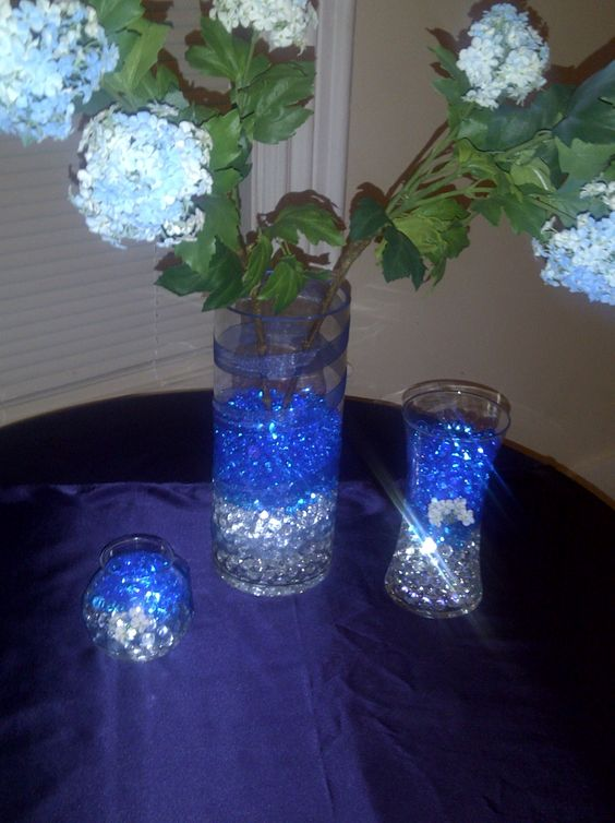 Centerpieces underwater lights and small vases on pinterest