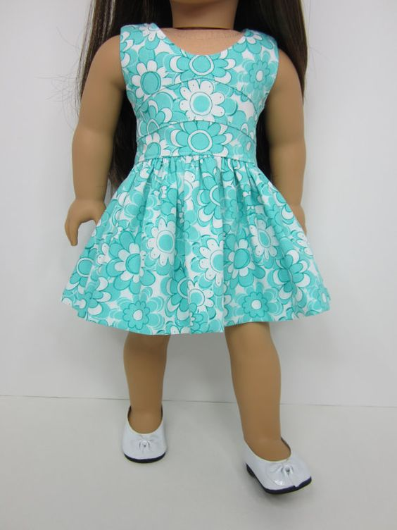 Aqua floral dress by JazzyDollDuds on Etsy. Made wuthering the Lisianthus Dress pattern. Find it at http://www.pixiefaire.com/products/lisianthus-dress-18-doll-clothes. #pixiefaire #lisianthusdress
