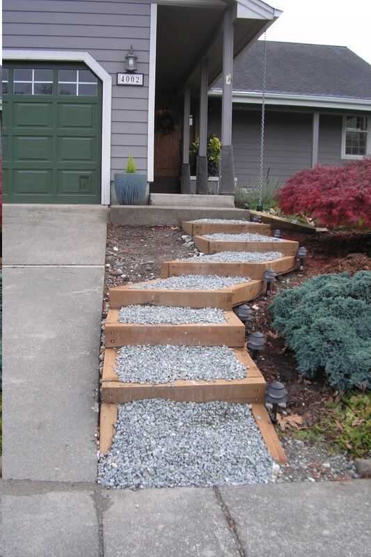 New Steps Through The Landscape Easier Than Walking Up The Steep Driveway Lighting Helps Too Drivew Garden Landscape Design Front Yard Driveway Landscaping