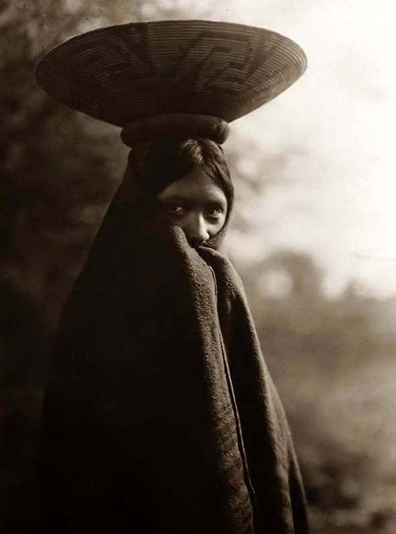 Here for your perusal is a highly creative photograph of Maricopa Girl Half-length Portrait Standing. It was created in 1907 by Edward S. Curtis.    The photo illustrates Indians of North America.    We have compiled this collection of photographs mainly to serve as a valuable educational resource. Contact curator@old-picture.com.    Image ID# A616A1ED: