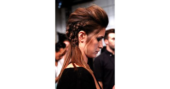 The second style at the Marissa Webb show was part braided undercut, part pompadour. Jeanie Syfu started with two cornrows along the sides and finished with a looser french braid down the center. This look is not for beginner braiders!