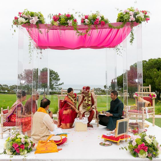 An Indian bride and groom wed in a traditional ceremony among family and friends.
