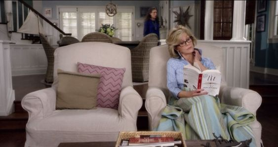 Grace and Frankie beach house living room with slipcovered armchairs. #graceandfrankie