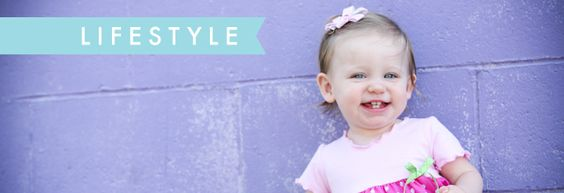Photography by Samantha McGranahan, The Roxy Studio. Lifestyle photography, family photography, sprout session, baby photography, teething, one year old child, baby girl, new teeth, cute little girl