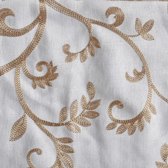 Embroidered gold scroll leaf pattern on white linen blend