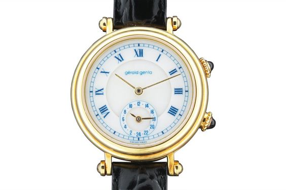 """""""Two-Time-Zone"""" Gérald Genta, """"Automatic"""", Ref. G3257.7, case No. 54234. Made in the 1990s. Self-winding, water-resistant, 18K yellow gold gentleman`s wristwatch with two time zones. White alabaster dial with painted blue radial Roman numerals, outer minute track, subsidiary dial for the second time zone. Yellow gold """"baton"""" hands. Original gold buckle. Accompanied by box, certificate and guarantee."""