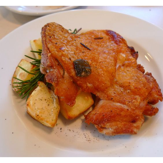 Herb chicken and potatoes, a classic dish.