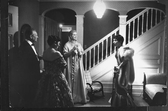 Preparing to attend the Academy Awards on March 30, 1955.   - ELLE.com