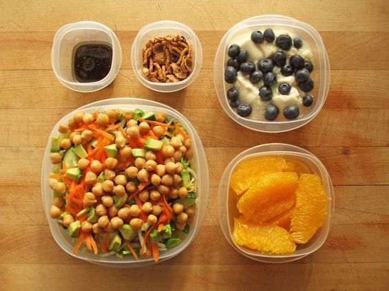 romaine salad with soybean sprouts, carrot, cucumber, chickpeas, avocado and balsamic vinaigrette, navel orange, and almond silken tofu with blueberries and nature's path optimum power blueberry cinnamon flax cereal