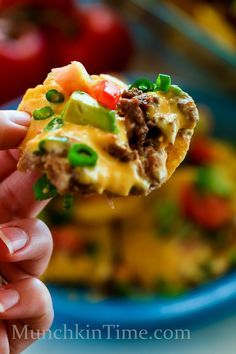 You will love 8 Ingredient Nachos Madness Recipe - made of tortilla chips, ground beef, cheese, tomatoes, avocados, green onion, and refried beans.