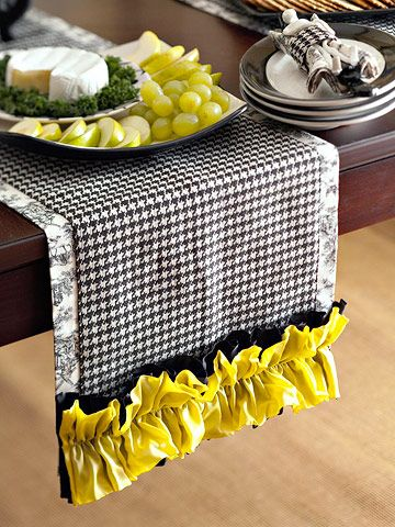 Black and white gingham table runner with yellow trim.