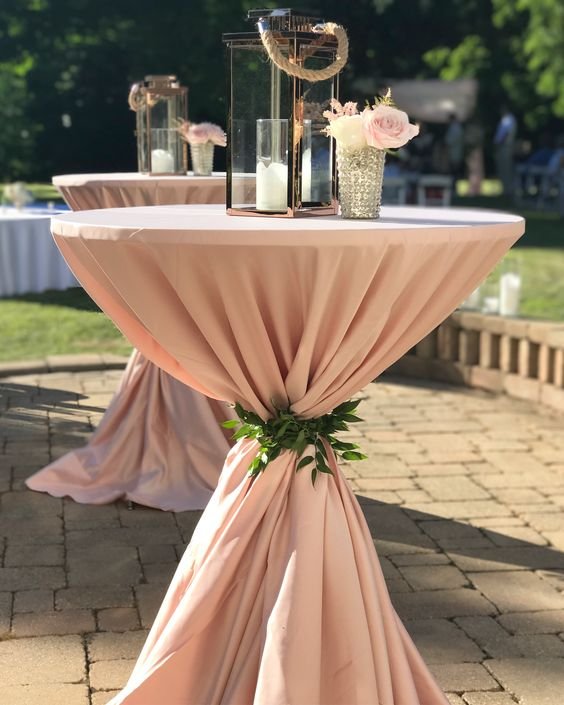 Blush pink cocktail table for outdoor wedding