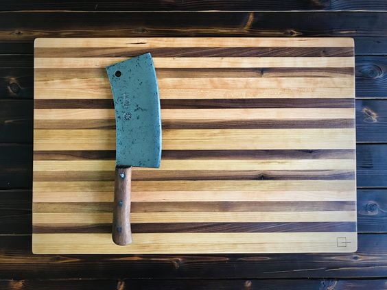 Black walnut and cherry butcher block with restored antique English cleaver.  Instagram @anchoragewood @upbeatvintage