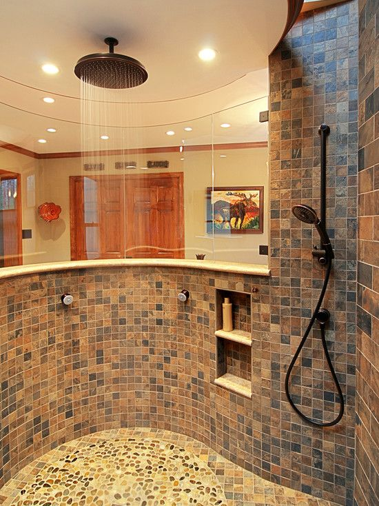 Dual shower heads, beautiful tile, not fully enclosed. Love this shower!