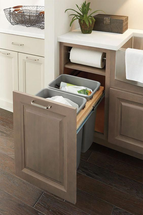Kitchen cabinet base with paper-towel roll holder built in - this is huge! #topkitchendesigns