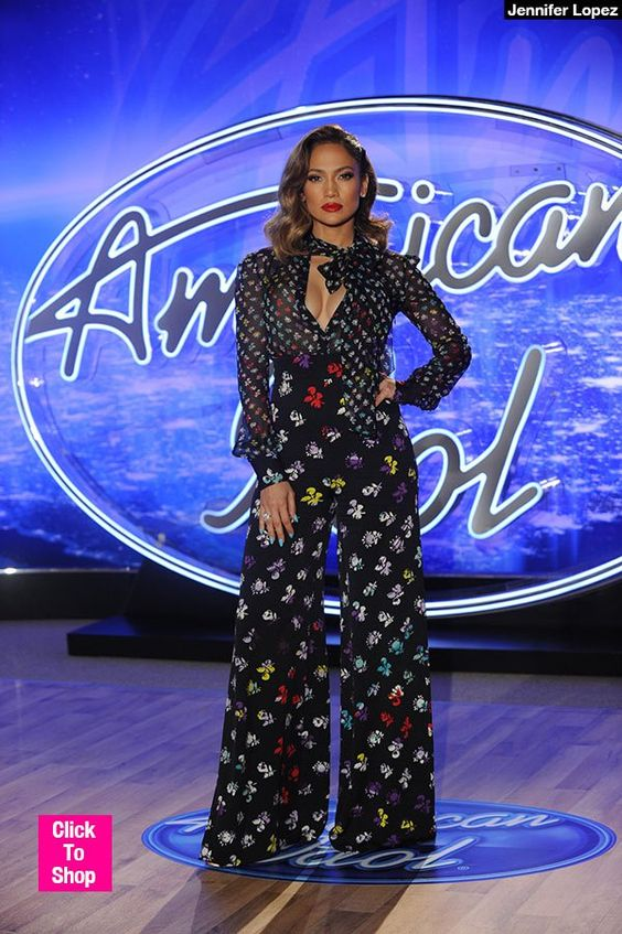 Jennifer Lopez headed to the season premiere of 'American Idol,' looking hotter than ever! She flaunted major cleavage in a colorful, floral print outfit. What did you guys think of her sexy look?