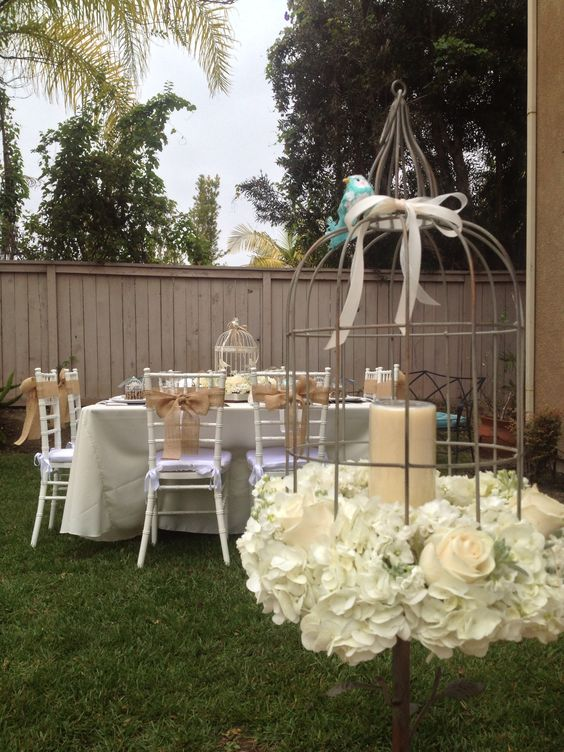 My sister's baby shower that my mother and I put together. Nesting theme. 4.14.13. Candle holder decorated with fresh flowers. Hydrangeas, roses, and stock.