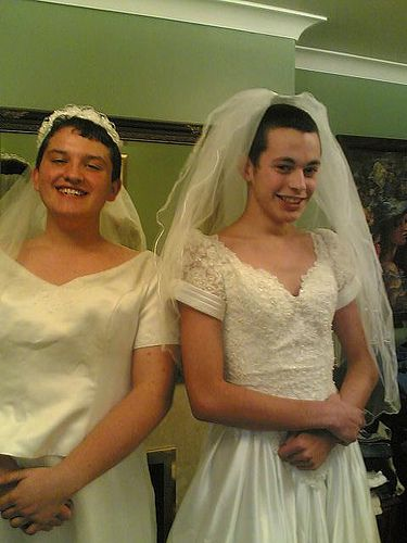 Two Boys Dressed Up As Girls In Wedding Dresses Cross