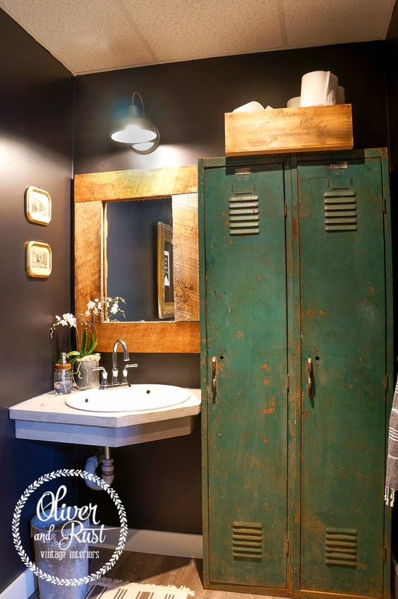 Oliver and Rust || sherwin williams black magic bathroom with concrete countertop, antique locker industrial storage