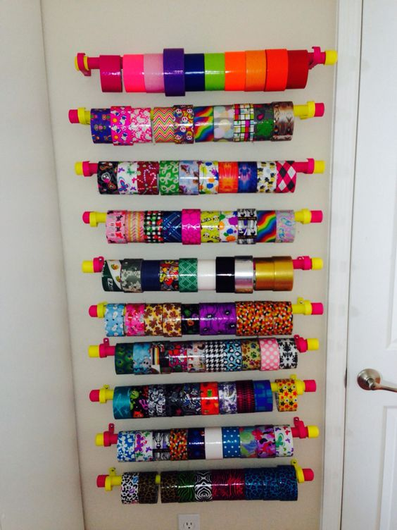 Duct (duck) tape roll wall organizer.