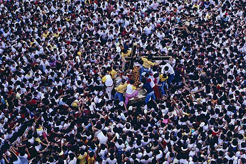 Every 9th of January a life-sized sculpture of Jesus called the 'Black Nazarene' is taken through the streets of Manila, the Philippines, in a procession.