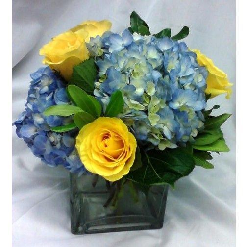 Yellow and blue cube vase centerpiece florals faunas