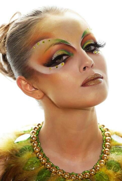 Crystal accented artistic and colorful fantasy make-up.: