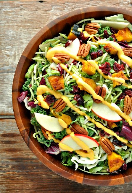 Topped with a healthy yet creamy dressing, this Fall Harvest Salad with Pumpkin Goddess Dressing is infused with Autumn's best flavors.