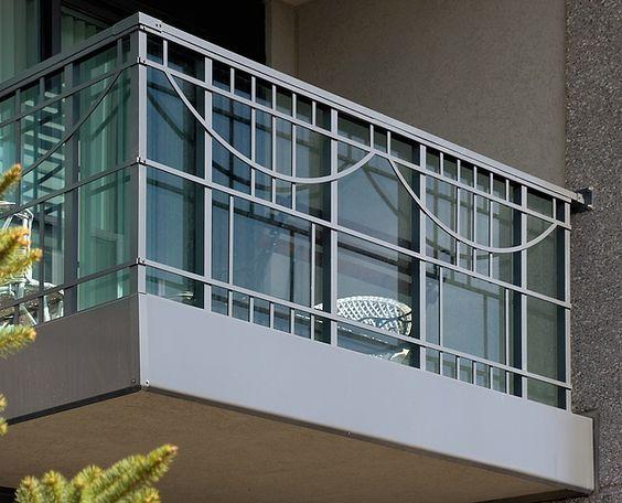 decorative aluminum railing. 38 Fontenay Court  Glass railing with decorative metal by Greco Aluminum Railings
