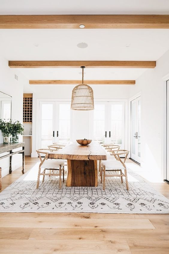 Rustic reclaimed table with white decor in a #modernfarmhouse dining room with #modernrustic decor