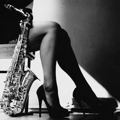 Sexy girl saxophone player black aand white here