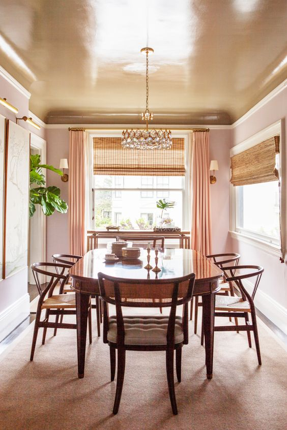 A neutral dining space with timeless style and a tan painted ceiling
