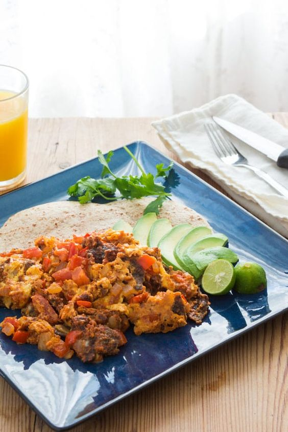 Tex-Mex style Migas made with eggs scrambled with tortillas, onions ...