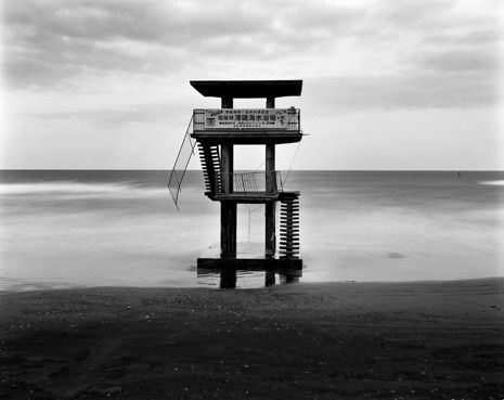 """Iwaki City. Normally, people can swim here. One of the signs on the chairs said, """"Do not eat any seafood up north from Chiba prefecture,"""" and fishermen decided not to fish when results of sea water and seafood tests came back to show high radioactive contamination. Kosuke Okahara.    Read more http://www.newyorker.com/online/blogs/photobooth/2012/03/dispatch-from-tohoku.html#ixzz1oSWQ24mL"""