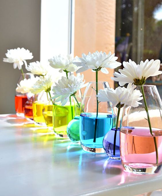 Rainbow Water Centerpiece: How insanely creative is this DIY centerpiece? Just add a drop of food coloring to each glass vase to turn your water totally technicolor. You can even try color blocking every other vase, or go with an ombre fade from deep purple to light blue. (via Papery & Cakery):