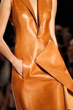 Sharp Leather Folds - tan leather dress detail; close up fashion