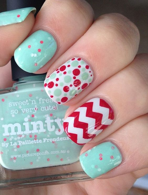 Make your nails an explosion of shapes and colors with this red and sea green color combination. You can add random zigzag shapes as well as pretty polka dot shapes alternatively on your nails.