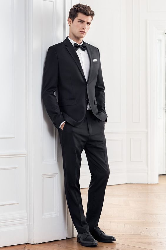 Wedding guest or bride groom, a black suit always looks good. Add