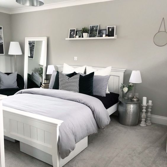 Light grey and white modern bedroom with white bedroom furniture