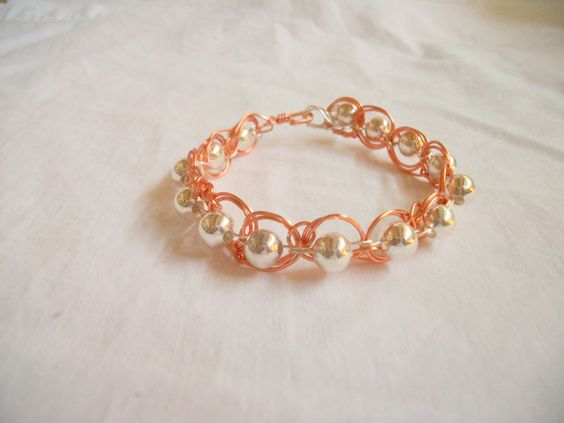 Wire Weaving Handmade Silver Beads and Copper Silver Wire Bracelet Great Birthday, Mothers Day, or Anniversary Gift by BarbsWireCreations on Etsy https://www.etsy.com/listing/184515739/wire-weaving-handmade-silver-beads-and