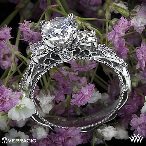 Love this! It's extra pretty! One of my favorites. This 3 Stone Engagement Ring is from the Verragio Venetian Collection. It features 1.00 ctw (F/G VS) round brilliant cut diamond melee to enhance a round, oval or square diamond center of your choice. The width tapers from 4mm at the top down to 3.3mm at the bottom. Select your diamond from our extensive online diamond inventory. Please allow 4 weeks for completion. Platinum rings carry a 5 week turnaround time.