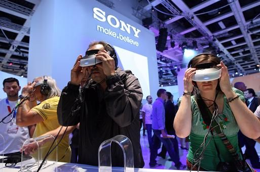 Visitors try out Sony's HMZ-T2 personal 3-D movie viewers at the IFA consumer electronics show in Berlin.